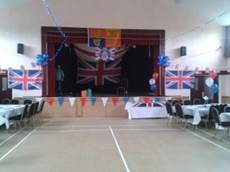 Main Hall and stage decorated for an event