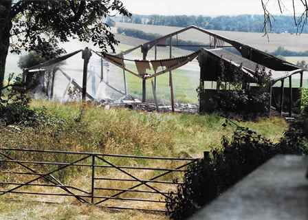 Remains of the Pilgrims Way barn after the fire in 1993. It was demolished shortly afterwards