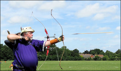 Arrow flies from bow