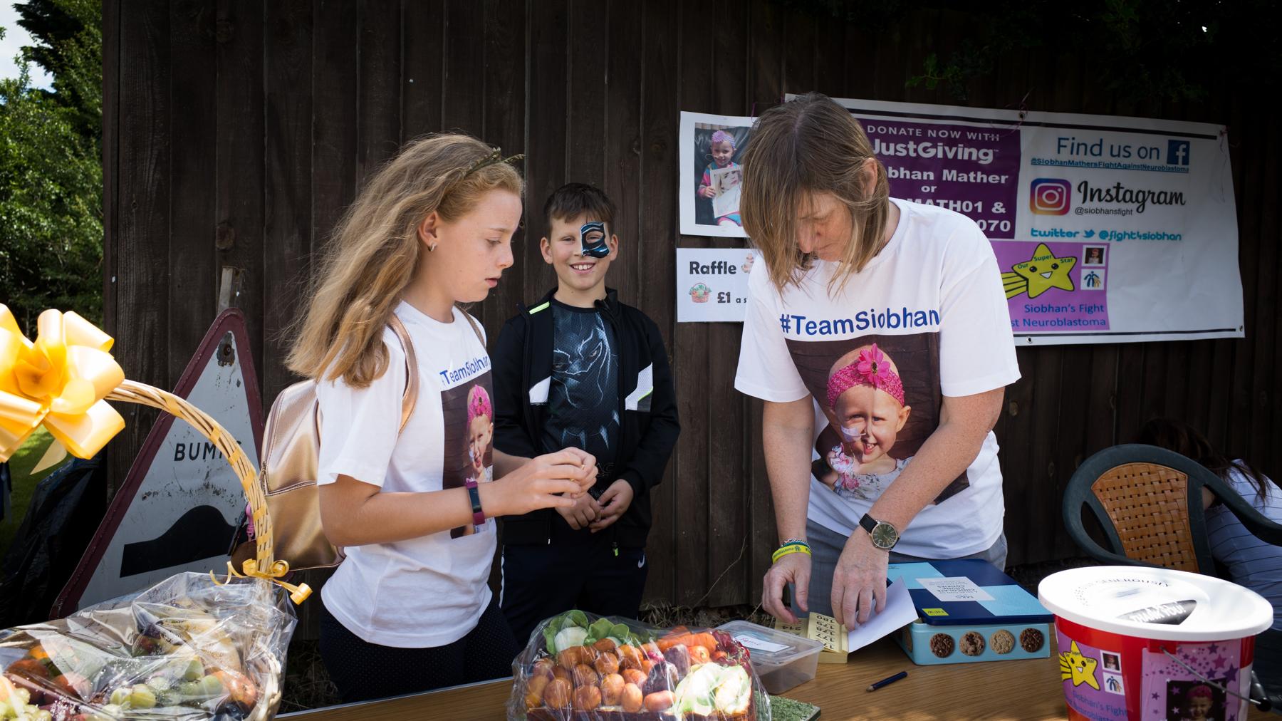 Cake and Basket of fruit raffle prizes.