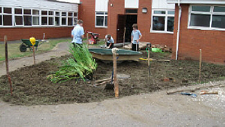 Pupils building pond