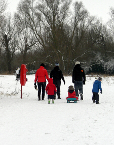 Family walk in the snow