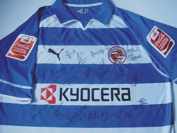 Signed Reading FC home Championship shirt with 19 signatures and the leauge sponsors badges.