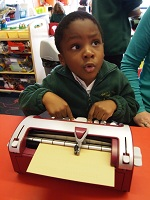 Pupil learning to use Brailler