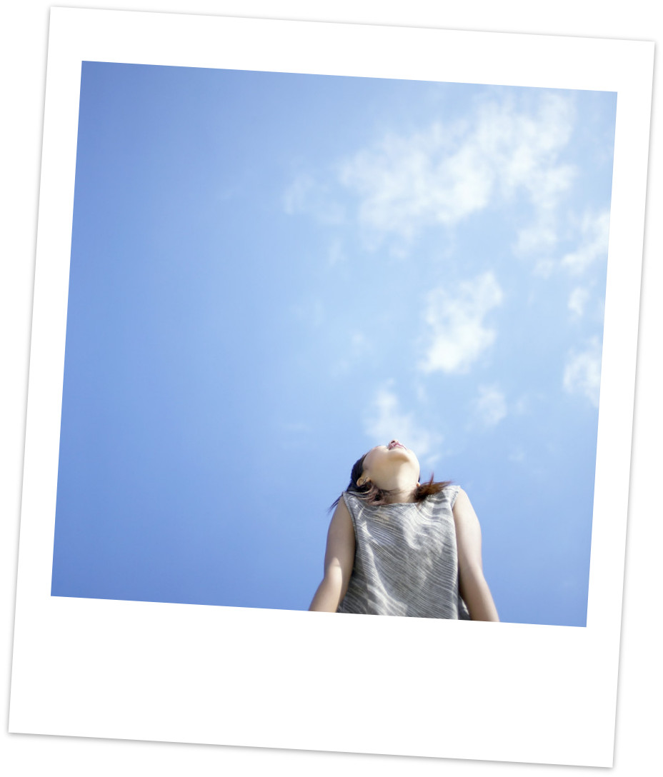 Photo of woman looking happy, looking up at sky